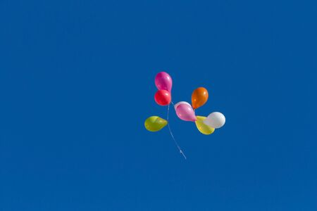 Colorful balloons flying through the air 版權商用圖片