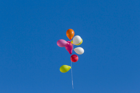 Colorful balloons flying through the air 스톡 콘텐츠