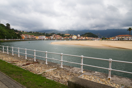 General view of the estuary in the coastal town of Ribadesella. With promenade, buildings and beach. Asturias. Spain