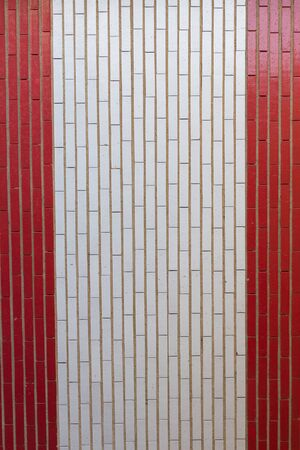 Brick Wall Access to garages painted in Red and White Bands