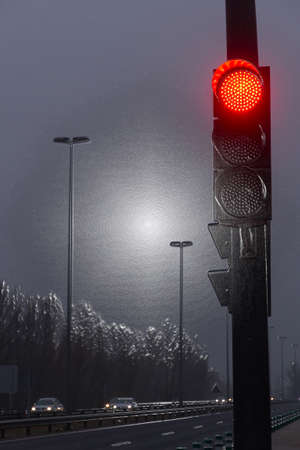 Red traffic light on highway, with plastic texture effect