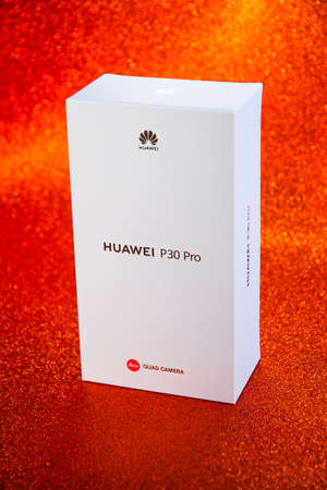 White Huawei P30 Pro case, with Leica lens isolated on an iridescent rugged orange red background Éditoriale