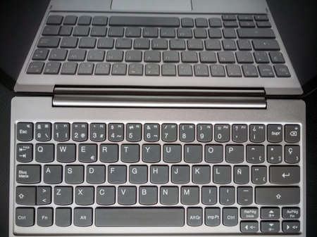 Laptop computer off, reflecting the keyboard on the screen