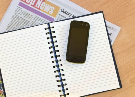 Notebook Mobile Newspaper photo
