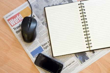 Notebook Mobile Mouse Newspaper photo