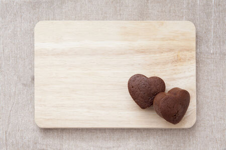 Chocolate Valentine Cake on wooden table  heart shape  photo
