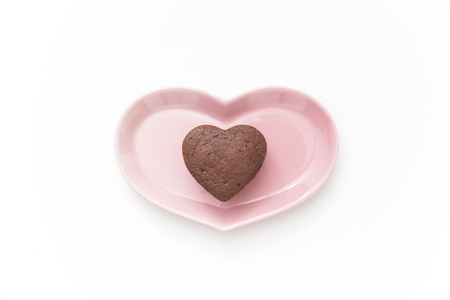 Chocolate Valentine Cake on pink plate (heart shape) photo