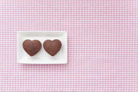 Chocolate Valentine Cake on pink cloth (heart shape) photo
