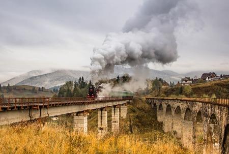 power giant: Retro steam train approaches mountains