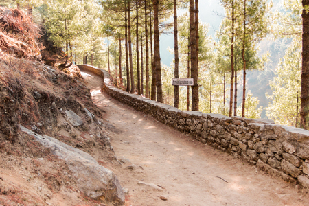 Himalayas landscape. Mountain range with trail in the forest. Everest Base Camp road. Trekking in Himalaya mountains, Nepal.