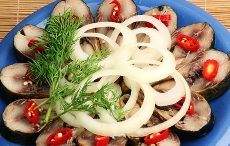 Smoked fish is sliced, red pepper, onion rings, dill  The Blue Plate Stock Photo - 13372273
