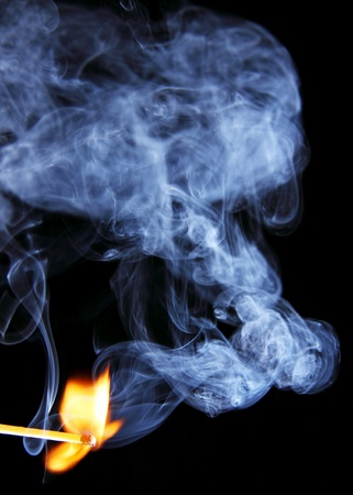 An illuminated light matches or smoke around her, Photo on a dark background  photo