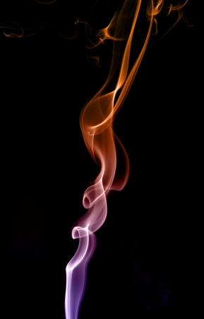 Clubs and tendrils of smoke of different colors isolated on a black background  Stock Photo - 18080681