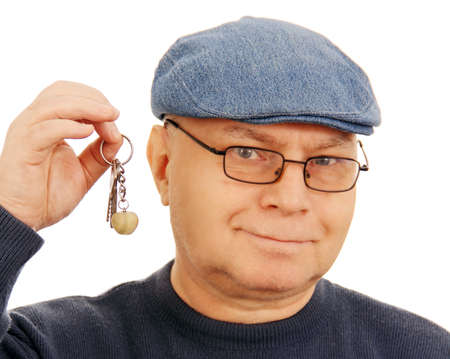 adult man holding a few keys, isolated on white background  photo