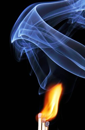 The fire and smoke from the burning and extinguished matches, photo on black background  Stock Photo - 18642752