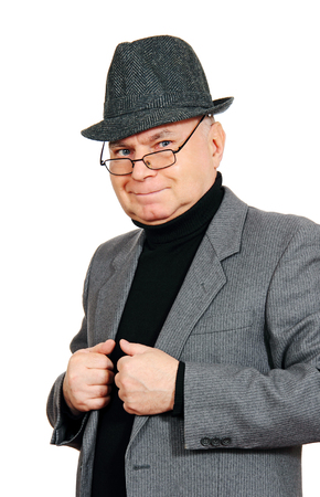 salut: adult man in a suit and hat, photo on the white .  Stock Photo
