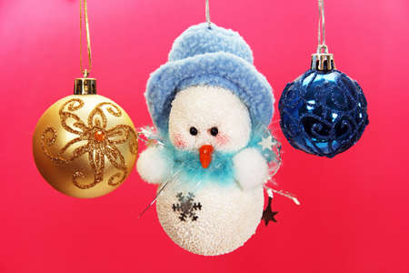 glass Christmas balls and snowman image on a colored . photo
