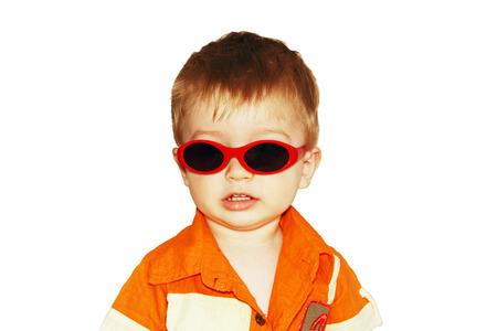 little boy wearing sunglasses, a photo on a white background. Standard-Bild