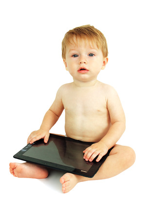 baby boy playing with a digital tablet, white background.
