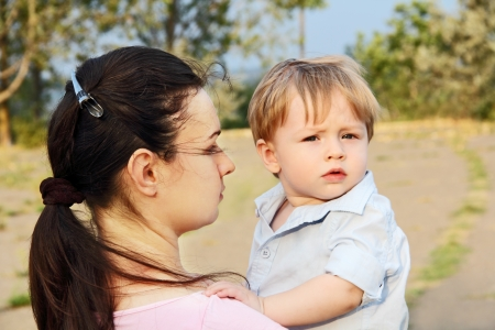 mother with a small child in the park in the summer.