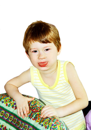 little boy sticks out his tongue, photo on the white background