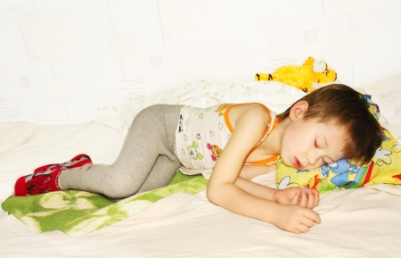 ittle: ittle baby asleep in bed, his head on the pillow close-up.  Stock Photo