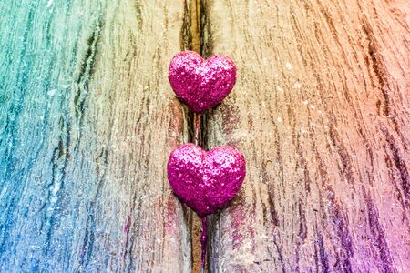 ramantic: Sparkling pink hearts on gradient wooden background