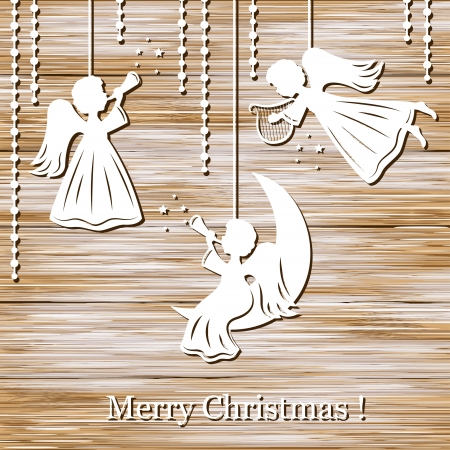 fairy light: Christmas background with angels cut of paper on wood