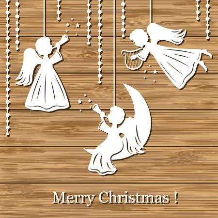 Sfondo Natale con gli angeli di carta tagliata su legno Archivio Fotografico - 15968472