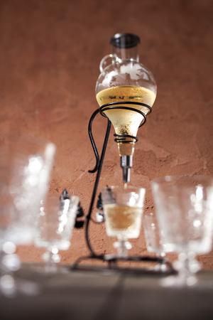metalic: a retro glass decanter pouring some white wine Stock Photo