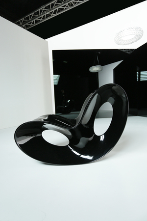 luxury room: a studio shot of modern black glossy rocking chair