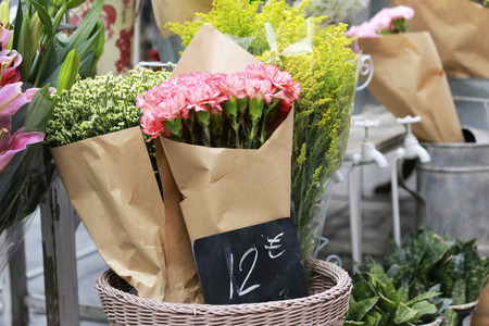 pink carnation in a basket at side way florist Stock Photo