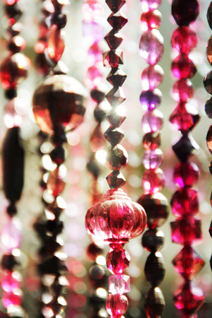 string of handmade bead curtains in Moroccan style have lighting effect