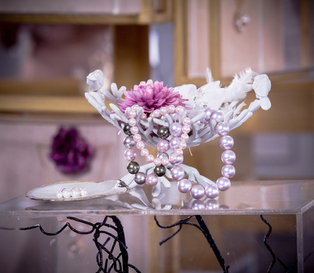 pearl necklace display in container coral shape