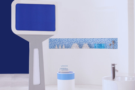 the setup of bathroom with a blue monitor used for shooting movie in studio