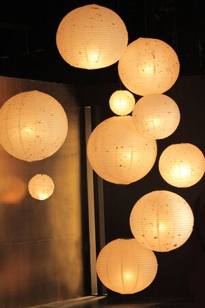 many lanterns are hanging in a dark room for decorated for party 스톡 콘텐츠