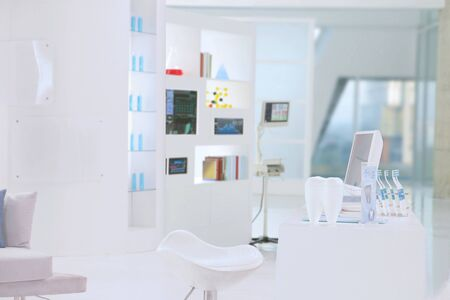 a reception table of dental clinic put in a modern white buiding 스톡 콘텐츠