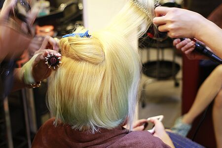 a blonde short hair girl was blow serviced by hairdresser in a salon