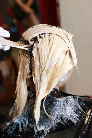 light color wet hair because of hair bleaching in salon