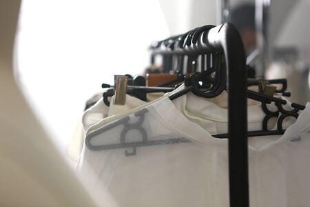 vareity white dresses hanging on black coat hangers