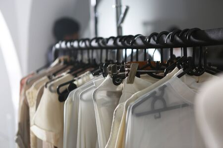 many clothes hanging on the black coat hangers