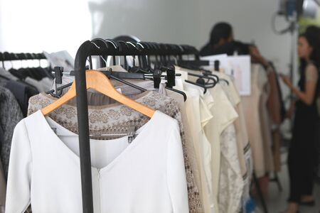many clothes racks on the backstage room for fashion show