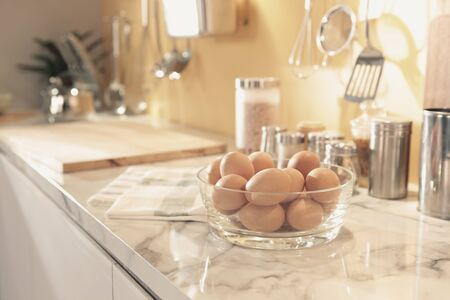 a glass egg bowl put on the kitchen counter prepare for cooking 스톡 콘텐츠