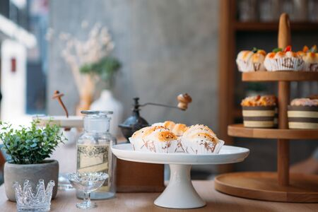 two difference cake stands and some bakeries put on counter bar in sidewalk coffee shop 스톡 콘텐츠