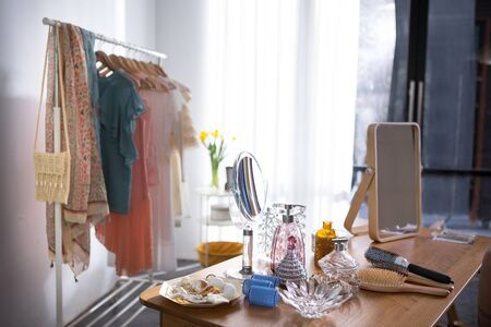 in a woman room there are a lot of beauty fashion accessories for dressing
