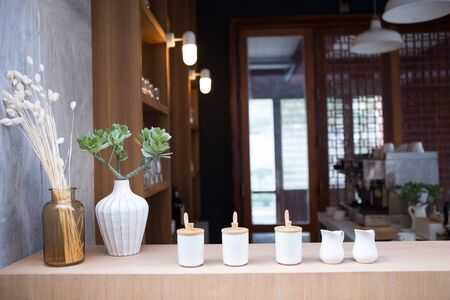 on the coffee counter bar have many ceramic mugs for milk, sugar and some ingredients 스톡 콘텐츠