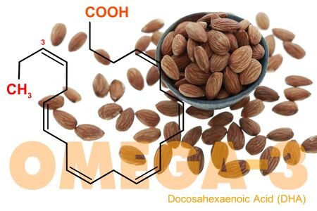 Almonds in the bowl double exposed with omega 3 DHA science structure on white 免版税图像
