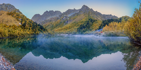 Morning mist on the Kardyvach lake. Caucasian Biosphere Reserve Stock Photo