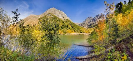 Golden autumn on the Kardyvach lake. Sochi, Russia