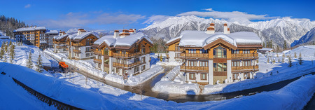 KRASNAYA POLYANA, SOCHI, RUSSIA - JANUARY 31, 2016: Snow-covered cottages Polyana 1389 hotel SPA. Mountain resort Laura, GAZPROM Editorial